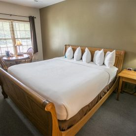 Room 1 King Bed with table and chairs