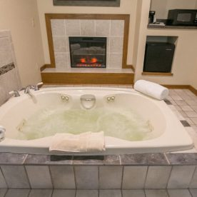 Jetted Tub with Fireplace in background
