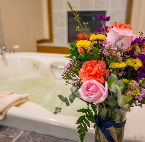 Bouquet of Flowers in front of a Jetted Tub in Room 10
